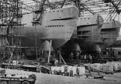 Allied soldiers inspect Type XXI U-boats after the capture of the shipyard in 1945.