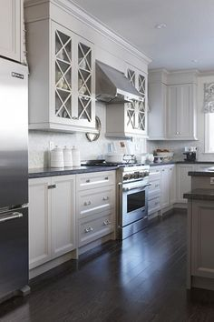 white cabinets carrara natural split face backsplash and pearl grey granite…