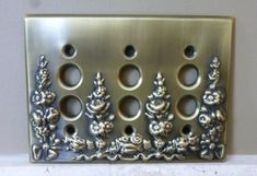 Triple push button switch plate cover. Decorative plate with beautiful raised floral patterning. Very pretty in an antique brass tone finish. Measurement: 4.5 tall x 6 wide. Fantastic Vintage Condition. All items will be packaged with care and shipped within 24 hours of purchase. Please visit my