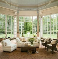 The brown wicker in this white living room help give it color and texture. All of the windows bring in a lot of light too. Outdoor Rooms, Outdoor Furniture Sets, Gates, Cute Living Room, Column Design, Room Additions, How To Clean Furniture, Sofa Furniture, White Furniture