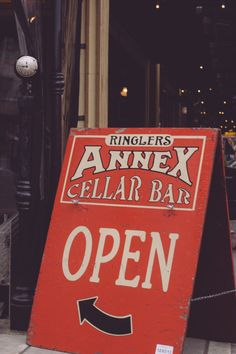 Street sign for Annex Cellar Bar in Portland, OR