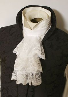 Victorian Historic White Three Ruff Jabot. Gorgeous white lace 3 ruff jabot, button on! Victorian pattern.  Lace Width: ~6 inches.  Lace fall: ~ 9 inches.  Twill collar and backing. Collar Length: Made to fit, send neck size with purchase.  Button collar fastening behind neck! (Request Velcro)