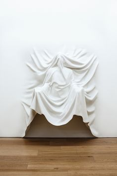 Daniel Arsham, Draped Figure with Arms Out, 2013. Image Courtesy the Artist and Galerie Perrotin, New York & Paris - p/o Remember the Future - Contemporary Arts Center, Cincinnati, OH