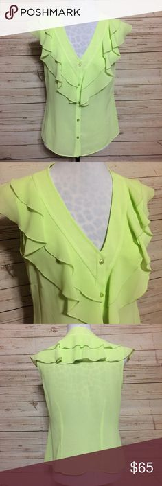 Oscar de la Renta Ruffled Blouse This perfect-condition Blouse is ready to Wow them all. Gorgeous ruffles along the neckline and down the center of this button down sleeveless Blouse are the perfect pop of color in chartreuse, almost a neon yellow. Looks amazing paired with black and white. Easy to dress up or down and very flattering on the body. Silky material drapes perfectly! Oscar de la Renta Tops