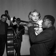 """Jeanne Moreau and Miles Davis during the recording of the music for #LouisMalle's film """"Elevator to the Gallows,"""" in December, 1957"""