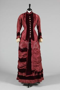 wine velvet and taffeta gown, circa 1880, with mother of pearl buttons