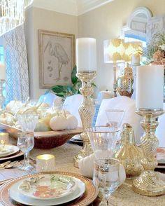 Pumpkin salad plates, wooden dough bowl, monogrammed votive holders:  Pottery Barn – Wine glasses and water goblets, Candleholders: Homegoods – Gold flatware:  Target  – Gold pierced ginger jars with lids:  Zgallerie.