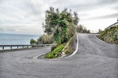 hairpin bend on hilly roads of Liguria region. #cycling #italy #italia www.velocecorporate.com