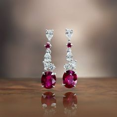 Gubelin (@gubelinofficial) on Instagram: The incredible hue of the two Burmese rubies, Ornament of Flowers drop earrings #OrnamentOfFlowers #MysticalGarden #FineJewellery #HauteJoaillerie #GubelinJewellery #Ruby #BurmeseRubies#GübelinJewellery #ColouredGemstones #Jewelry #ColouredGemstones