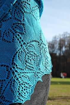 """""""Frog Princess"""" is a triangular lace shawl knitted from the center outwards, featuring 181 rows in charted instructions. While the chart is accompanied by detailed instructions, the lace pattern is not written out row by row – you need to be able to work from charts in order to make this shawl."""
