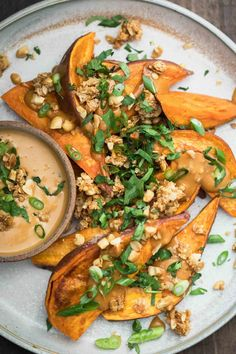 These sweet potato wedges are a lovely vegan and gluten-free snack or dinner with roasted sweet potatoes smothered with peanut sauce and peanut granola. Veggie Recipes, Vegetarian Recipes, Healthy Recipes, Healthy Side Dishes, Vegan Dishes, Naturally Ella, Sweet Potato Wedges, Eat Seasonal, Peanut Sauce