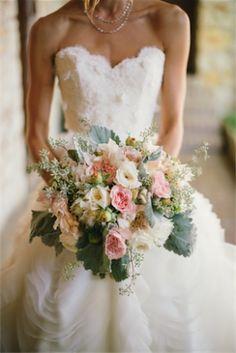 PreOwnedWeddingDresses.com Real Weddings   Photo:  Delbarr Moradi Photography
