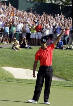 He's back.....Tiger Woods raises his putter after making a birdie putt on the 18th hole and wins the Memorial Golf Tournament 2012.