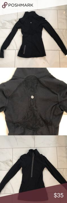 Lululemon 1/2 ZIP Sz 2 Super cute black 1/2 zip by Lululemon. Has lace & ruffle detail on the back and lace on the inside seam of the arms. Front pouch and back zipper pocket. lululemon athletica Other