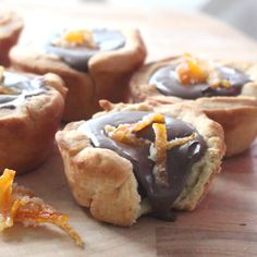 Candied Orange Chocolate Tarts - Add a bit of zest to yummy chocolate pastries with candied orange peels.