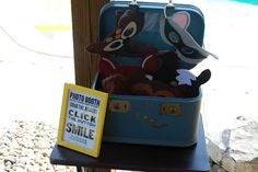 A suitcase is a cute idea for props for a photo booth