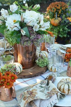 ❧ Tablescapes ❧ Fall alfresco tablesetting with copper wine bucket flower arrangement | ©homeiswheretheboatis.net #fall #alfresco #lake #flowers #hydrangeas #FloralFriday #tablescape #pumpkins