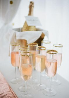 Pink bubbly with a gold sugar trim.