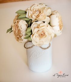 Gorgeous shabby chic paper flower arrangement! This full size mason jar is filled with paper roses and peonies! Perfect centerpiece for weddings, home decor, or as a gift.