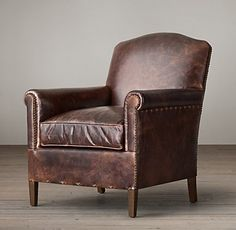 RH's 1920s French Camelback Leather Club Chair:In the parlors and salons of 1920s France, seating was often compact in form but lavish in comfort. Our chair follows suit. Trim, scrolled arms, tapered legs and a graceful camel back lend it soigné proportions, while the deep, thickly cushioned seat encourages lounging.