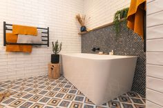 Team yellow, Amy and Stu, pulled off win after win on this season of The Block NZ. See inside their sunshine yellow home here. Bathroom Tile Designs, Bathroom Design Small, Bathroom Ideas, Bathroom Bin, Bathroom Laundry, Bathroom Inspo, Small Bathrooms, Bathroom Towels, Bad Inspiration