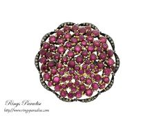 $1,208 RUBY AND DIAMOND FLOWER RING www.ringsparadise.com
