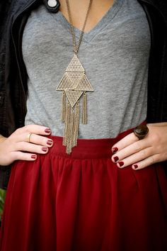 Red maxi skirt, tee, statement necklace.