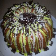 St Patrick's Day pound cake…Whipped Cream Pound Cake topped with white chocolate, drizzled vanilla & mint glaze and Andes chocolate #EuniqueTreats2014