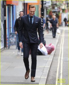 tom hiddleston wears a suit better than anyone else 15 Tom Hiddleston flashes his electric smile while stepping out on Thursday afternoon (September 3) in the Soho neighborhood of London, England.    The 34-year-old…