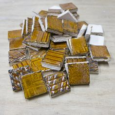 """Handmade ceramic mosaic tiles from Mercury Mosaics.  Pretty Amber color 1""""x1"""" tiles with 4 different textures."""