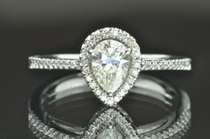 .75 Carat Pear Halo Diamond Engagement Ring/.50 Center, $1600.00
