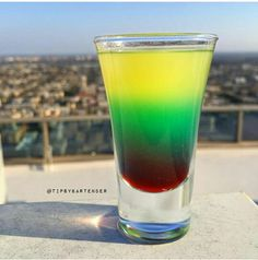 Captain morgan,Malibu rum,Pineapple Juice,Grenadine,and blue curaco. Captain on Acid shot Id turn it into a drink
