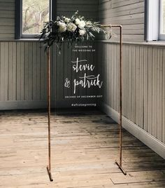 Modern wedding sign / with copper pipe base and lettering on clear signage
