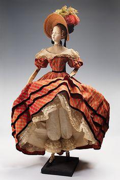 """1832 Doll""  Marcelle Dormoy (French)  Designer: Rose Descat Designer: Antoine (French) Date: 1949 Culture: French Medium: metal, plaster, hair, silk, straw, cotton, feather, linen Dimensions: 32 1/2 x 17 in. (82.6 x 43.2 cm) Credit Line: Brooklyn Museum Costume Collection at The Metropolitan Museum of Art, Gift of the Brooklyn Museum, 2009; Gift of Syndicat de la Couture de Paris, 1949"