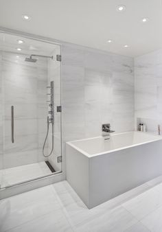Infinity Drain linear drain in the bathroom shower enclosure at 140 Charles Street, NYC. Designed by Giusi Mastro of Ora Studio.