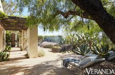 Nestled in the mountains, this Santa Barbara, California home was designed in 1992 by local architect Bob Easton. Reflecting the Southwestern aesthetic, traditional flowers have been replacedwith aunique cactus garden where residents and their guests can escape from the sun andunwind on the chaise longues.