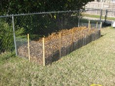a quick DIY project that will help you ''corral'' the great and FREE garden resource - leaves. I call it the Fall leaf collection bin.  -Maybe behind the shed?