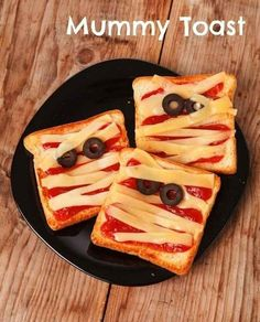 Mummy toast | 26 Healthy Halloween Snack Hacks Modified Mummy Toast for breakfast with strawberry jam, cranberry eyes and removed crust from toast to create toast strips of bandages. The kids loved their Mummy toast for breakfast!