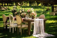 lace table runner cascades off table at shabby chic vintage wedding