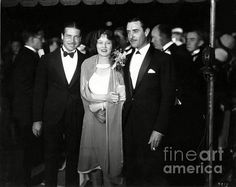 Walter Morosco, Corine Griffith and John Gilbert  at the Carthay Circle Theatre in Los Angeles for the premiere of Colleen Moore's film, Lilac Time (1928). Sad Hill Archive / Bizarre Los Angeles