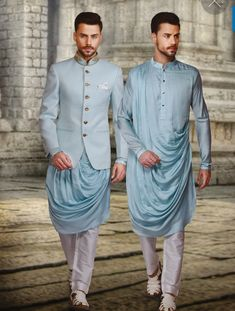 Light blue bandhgala with cowl kurta. Whatsapp on +91 9013201999 for more details.