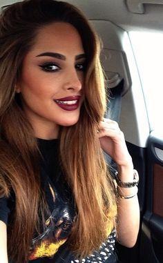 Dark Lips, full brows, and eyeliner.