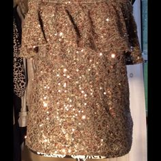 Sequined strapless halter top. Great little sequined halter top with ruffled bust.  Looks good with a mini skirt or jeans/capris for a date or club night.  Has zipper in back and is lined.  The color is green with copper/gold sequins, Ark & Co Tops Crop Tops