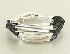 This multi-strand style gives this cuff a fashion forward look with cotton cord and metal links.