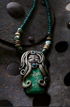 Green Magnesite Goddess and Chrysocolla Gemstone Beads Handcrafted Necklace.  Materials: polymer clay, gemstone beads, tibetan silver, Magnesite.  $94.35