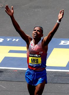 Pin for Later: Boston Marathon Bombing Survivors Triumphantly Cross the Finish Line  US winner Meb Keflezighi held his hands up to the sky as he crossed the finish line.