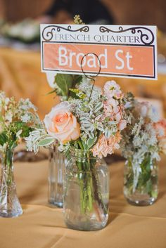 Pale Peach Rustic Floral Arrangements In Mason Jars | Rustic Bohemian Summer Charleston South Carolina Wedding At Boone Hall Plantation | Photograph by Priscilla Thomas Photography  http://storyboardwedding.com/rustic-bohemian-summer-charleston-south-carolina-wedding-at-boone-hall-plantation/