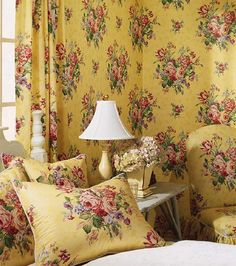 Love the color combo on this chintz, and the lavish use of it here. I'd also use it for curtains in my kitchen; I grew up with some that were very similar.