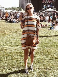 Courtney Trop of Always Judging wears a striped shift dress with Converse sneakers and a tan bucket bag
