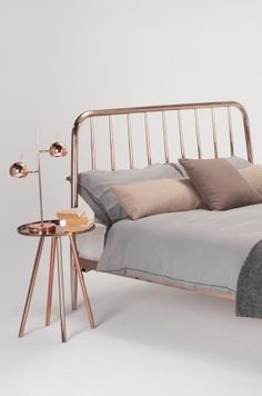 The Alan Double bed in Copper. The delicate frame's slender profile and rosy glow add drama without dominating. £399 | MADE.COM